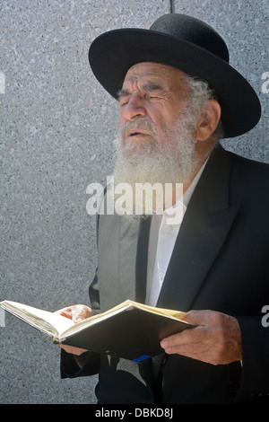 Religious Jewish man in fervent prayer at the Ohel, the resting place of the Lubavitcher Rebbe in Cambria Heights, - Stock Photo