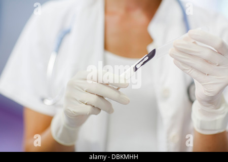 Doctor Holding Scalpel, Close-up - Stock Photo