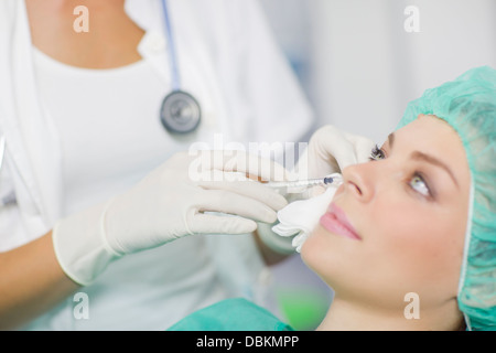 Woman Getting A Botox Injection On Her Face - Stock Photo