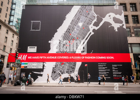 A sign advertises the imminent arrival of an H&M department store on Fifth Avenue in New York - Stock Photo