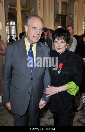 Frederic Mitterrand and Liza Minnelli Liza Minnelli is awarded with chevalier of the Legion of Honour (Chevalier - Stock Photo