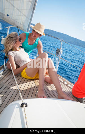 Croatia, Adriatic Sea, Young couple on sailboat relaxing - Stock Photo