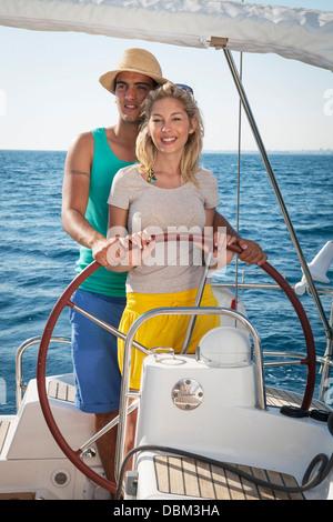 Croatia, Adriatic Sea, Young couple on sailboat - Stock Photo