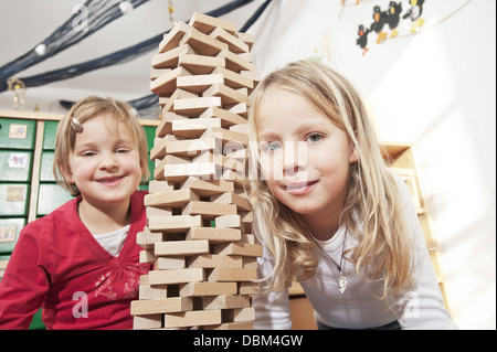 Two Girls Playing In Nursery School, Kottgeisering, Bavaria, Germany, Europe - Stock Photo