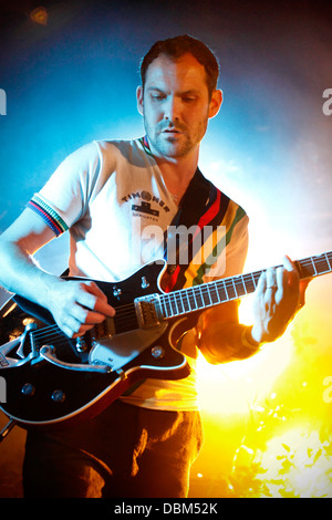 Martin Noble of  British Sea Power performing live at Kendal Calling Festival 2013 on the Calling Out Stage - Stock Photo