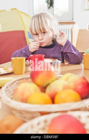Little Boy Sitting At Table In Nursery School, Kottgeisering, Bavaria, Germany, Europe - Stock Photo