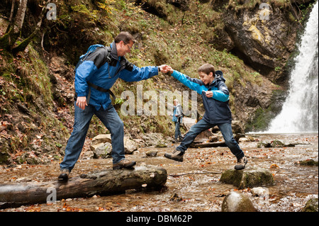 Father And Son Exploring Nature, Germany, Bavaria, Europe - Stock Photo