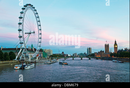 Houses of Parliament and Eye from Hungerford Bridge Night London UK - Stock Photo
