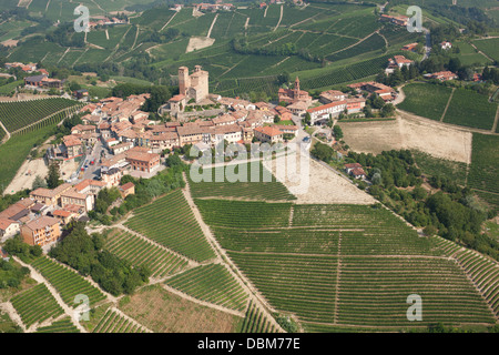SERRALUNGA D'ALBA CASTLE (aerial view). Village on top of hill surrounded by grapevines in the Langhe region of - Stock Photo