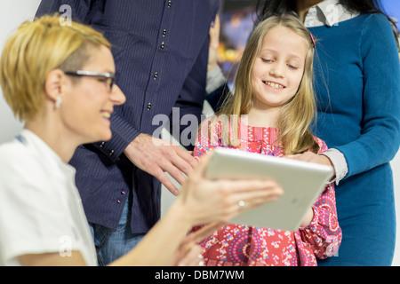 Female doctor explains diagnosis to girl, using a digital tablet, Osijek, Croatia - Stock Photo