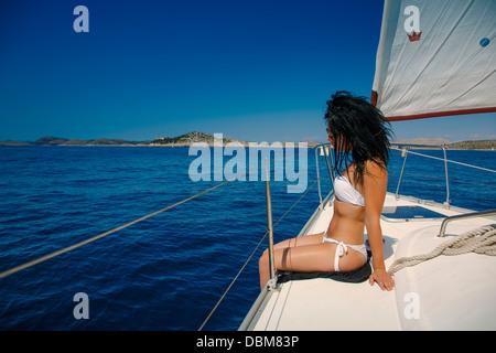 Young woman relaxing on yacht, Dugi Otok, Dalmatia, Croatia - Stock Photo
