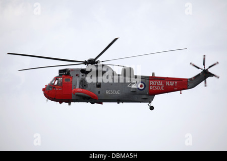A Royal Navy Westland Sea King HU5 helicopter flying at the 2013 Sunderland International Airshow. - Stock Photo