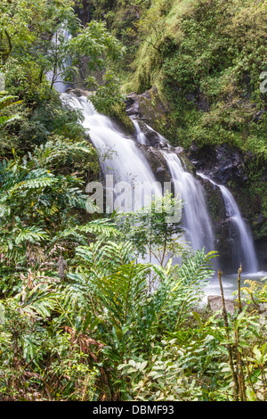 'Waikani Falls' or 'Three Bears Falls', one of the many waterfalls along the Road to Hana on the island of Maui - Stock Photo