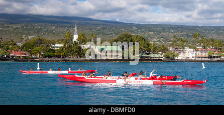 Outrigger canoe club practices in Kailua Bay on the Big Island of Hawaii - Stock Photo