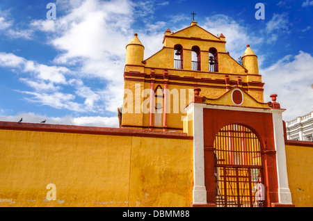 Yellow and red colonial style church in the town of San Cristobal de las Casas in Chiapas, Mexico - Stock Photo