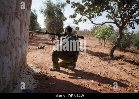 October 28, 2012 - Aleppo, Syria: Free Syrian army rebel aim at regime positions during the Eid Al Adah holiday - Stock Photo