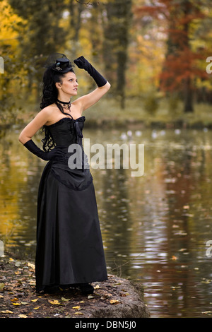 Young Woman In Gothic Style Fashion Stands On The Waterfront Croatia Europe