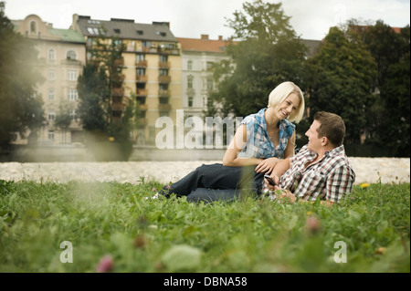 Young couple relaxes outdoors, Munich, Bavaria, Germany - Stock Photo