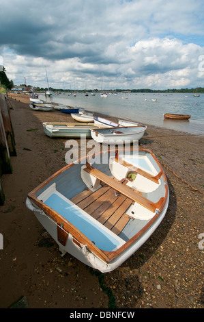 Small boats seen on and beside a river in south east England. - Stock Photo