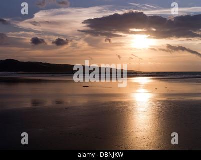 dh Ninety Mile Beach AHIPARA NEW ZEALAND Sunset over Ahipara Bay orange brown sky sea sand coast northland - Stock Photo
