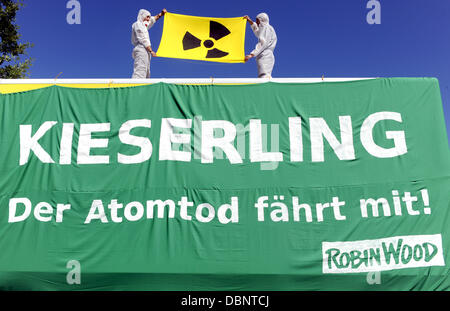 Activists of German environmental advocacy group Robin Wood protest on a truck in front of the site of haulage company - Stock Photo