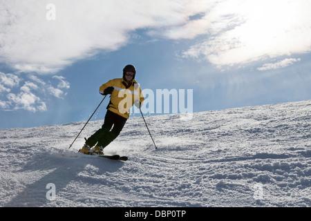 Young woman skiing downhill, Sudelfeld, Bavaria, Germany - Stock Photo