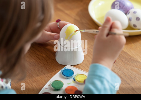 Little girl coloring Easter eggs, Munich, Bavaria, Germany - Stock Photo