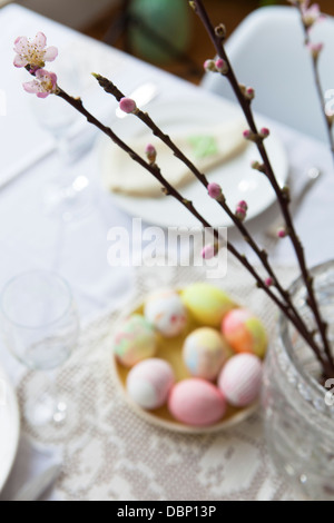 Easter breakfast, set table with painted eggs and cherry blossom, Munich, Bavaria, Germany - Stock Photo