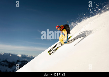 Backcountry skier skiing downhill, Alpbachtal, Tyrol, Austria, Europe - Stock Photo