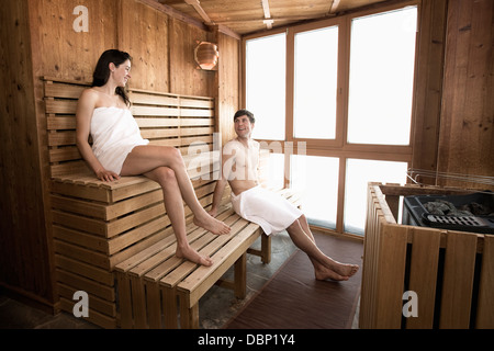 Young couple relaxes in sauna, Salzburger Land, Austria, Europe - Stock Photo