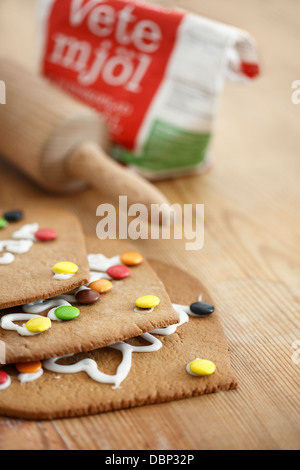 Rolling pins and cookies on cutting board - Stock Photo