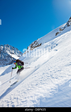 Female skier skiing downhill, Stubai, Tyrol, Austria - Stock Photo