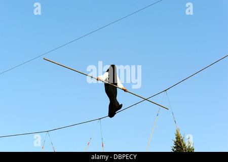 Ropedancer's performance in a black bag - Stock Photo