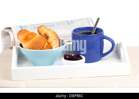 Fresh coffee and tasty croissant in a tray for breakfast. with newspaper, on white background - Stock Photo