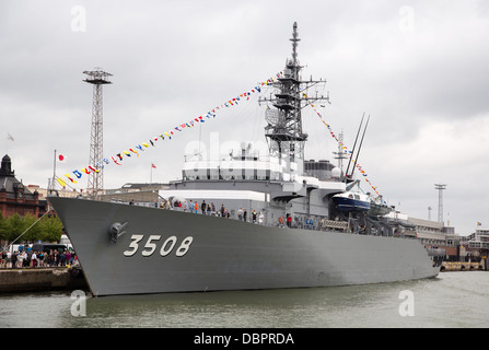 JS Kashima, a training ship of the Japan Maritime Self Defense Force, moored and flagged in the South Harbor of - Stock Photo