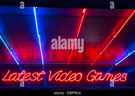 31/07/2013 Latest Video Games neon sign at Electric Avenue amusement arcade on the seafront in Southend-on-Sea - Stock Photo