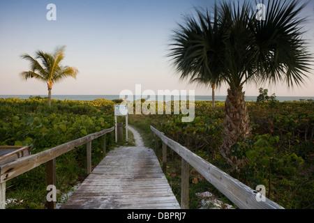 Boardwalk on to beach, Sanibel Island, Florida - Stock Photo