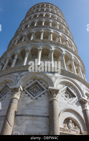 Famous Leaning Tower in Pisa angle shot on piazza dei Miracoli. - Stock Photo