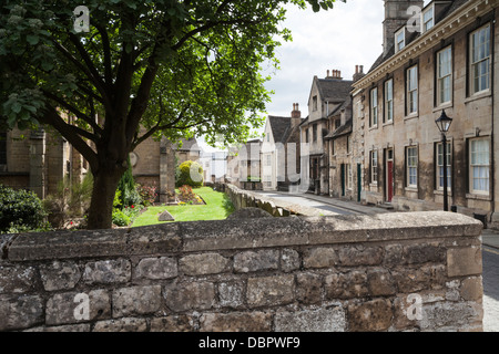 The typically Georgian stone architecture of St Georges Square beside St George's church in Stamford, Lincolnshire, - Stock Photo