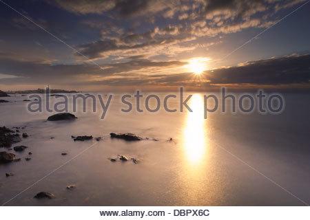 Rising sun at the ocean - Stock Photo