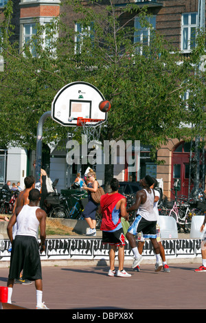 Various STREET activities taking place at Islands Brygge Copenhagen in a project called StreetMekka. Street basketball. - Stock Photo