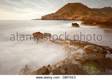 Rising sun at Cabo de Palos, murcia, Spain. Sunrise at the beach - Stock Photo
