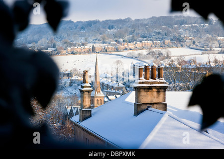 Winter view looking across the snow covered rooftops in Bath, UK - Stock Photo