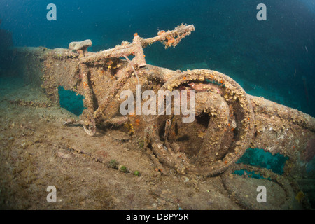 A bicycle on the deck of the wreck of the Mr. Bud, a former shrimping boat, scuttled off the island of Roatan, Honduras - Stock Photo