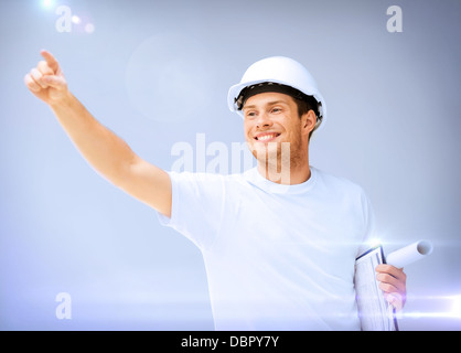 male architect in helmet with blueprint - Stock Photo
