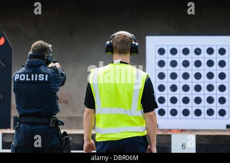 Ballykinlar, Northern Ireland. 2nd August 2013 - A Finnish police officer shoots a Glock 19 handgun Credit:  Stephen - Stock Photo