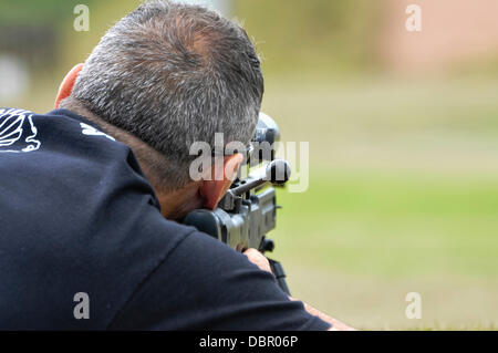 Ballykinlar, Northern Ireland. 2nd August 2013 - A man fires a Remington 700P bolt-action sniper rifle Credit:  - Stock Photo