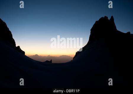 Sunrise over Peuterey ridge, Italian Alps, Mont Blanc masif. Aiguille Blanche De Peuterey seen from base of Freney - Stock Photo