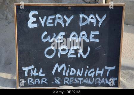 Open sign in blackboard and white chalk saying 'every day we are open till midnight'. - Stock Photo