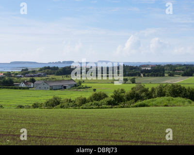 Newly planted fields in Sola, an agricultural area outside Stavanger Norway , farms with north sea and horizon as - Stock Photo